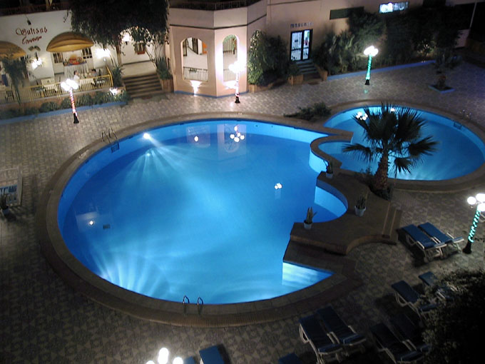 9r empire hotel by night pool.253162132 std Home Pools